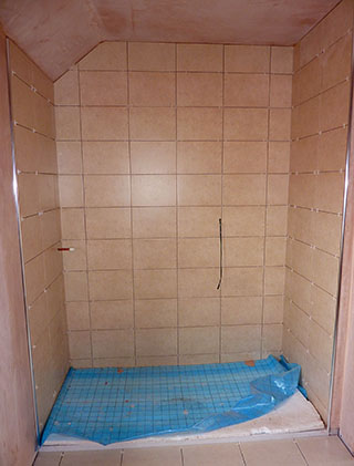 shower cubilcle with beige wall tiles