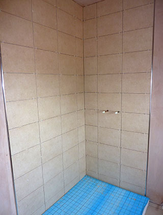 Showe cubicle with beige tiles