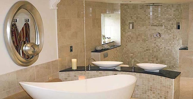 Modern bathroom finished in marble tiles and mosaics